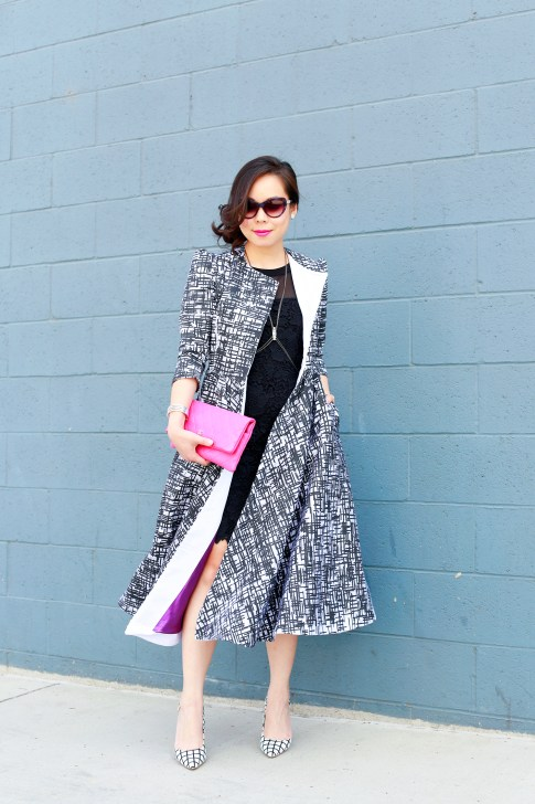 An Dyer wearing Kut from the Kloth Lace Dress, Chanel Pink QUilted Clutch, Bulgari Sunglasses with Doku AME'YO MARBLE LONG COAT, and JustFab Windowpane Pumps