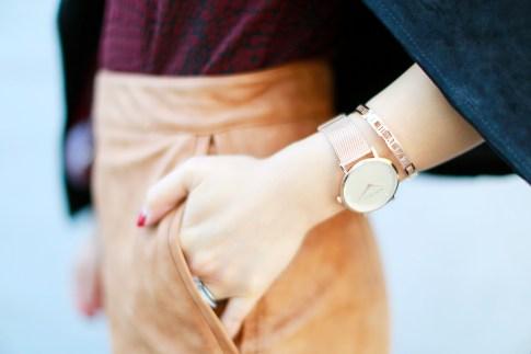 An Dyer wearing The Peach Box Marc Bale rose gold watch