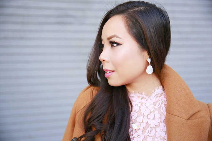 An Dyer wearing Charming Charlie Pearl Ivory Clip On Dangly Earrings
