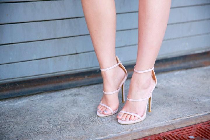 An Dyer wearing Public Desire 3 strap nude sandals