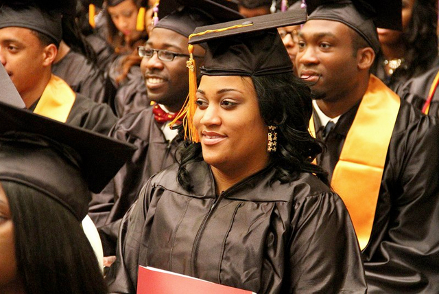 Image of female student smiling at her graduation ceremony at a top 25 HBCU.