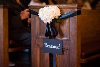 White floral décor with black satin ribbon at Toronto Wedding ceremony