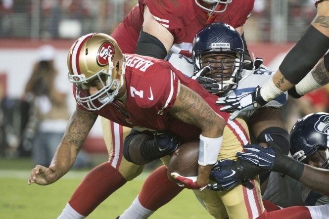 October 22, 2015; Santa Clara, CA, USA; Seattle Seahawks defensive tackle Brandon Mebane (92) sacks San Francisco 49ers quarterback Colin Kaepernick (7) during the fourth quarter at Levi's Stadium. The Seahawks defeated the 49ers 20-3. Mandatory Credit: Kyle Terada-USA TODAY Sports