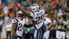 Aug 15, 2014; Foxborough, MA, USA; New England Patriots corner back Malcolm Butler (29) and cornerback Darrelle Revis (24) react after the Patriots recovered a loose ball by the Philadelphia Eagles during the preseason game at Gillette Stadium. Mandatory Credit: David Butler II-USA TODAY Sports