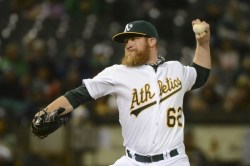 April 21, 2014; Oakland, CA, USA; Oakland Athletics relief pitcher Sean Doolittle (62) delivers a pitch against the Texas Rangers during the eighth inning at O.co Coliseum. The Rangers defeated the Athletics 4-3. Mandatory Credit: Kyle Terada-USA TODAY Sports