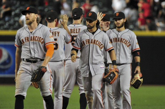 Jul 18, 2015; Phoenix, AZ, USA; San Francisco Giants right fielder Hunter Pence (8), third baseman Matt Duffy (5) center fielder Angel Pagan (16), first baseman Brandon Belt (9) and shortstop Brandon Crawford (35) celebrate after beating the Arizona Diamondbacks 8-4 at Chase Field. Mandatory Credit: Matt Kartozian-USA TODAY Sports