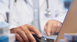Doctor preparing online internet prescription selective focus