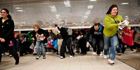 Shoppers Entering a Store on a Black Friday, as it Opens, Racing to Reach Their Merchandise First.