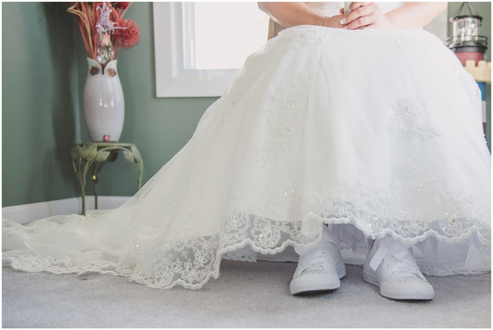 south jersey wedding photographer, bride getting ready portraits, lace back gown, bird cage veil, converse wedding shoes