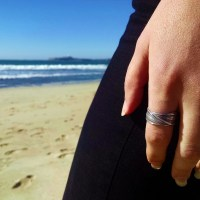 Mitsuro Band worn by model on the beach.