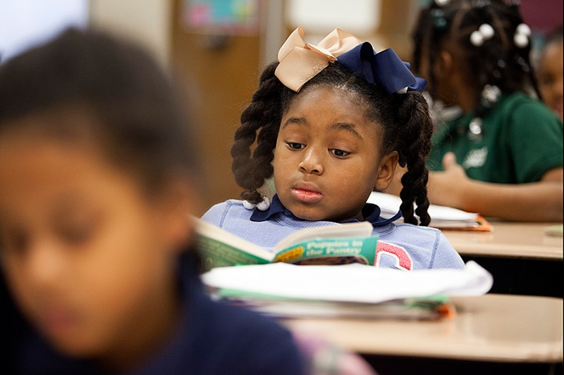 Third-grade students at Sylvanie Williams College Prep elementary school read individually in class, on Jan. 16, 2015, in New Orleans. Fifty percent of the children here started the academic year below grade level in reading and math. The goal is to help them catch up and keep making progress. (Reproduction of this photo not permitted)