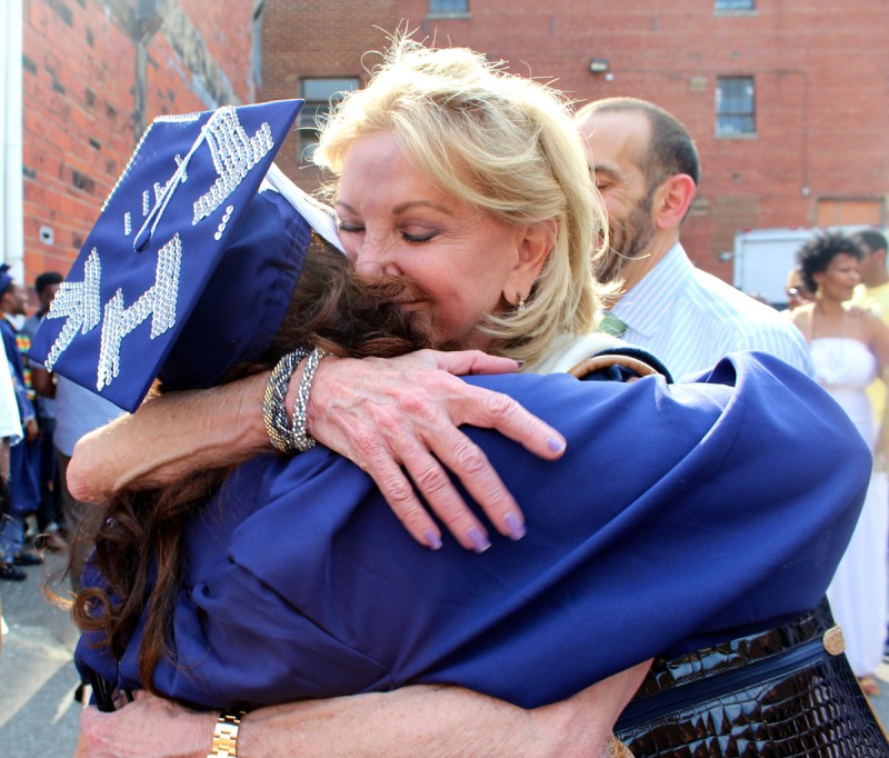 Elaine Wynn, right, chair of the board of directors for Communities In Schools, congratulates Talitha Halley. In the years since Halley fled Katrina, the organization helped her realize her goal of graduating from Howard University.