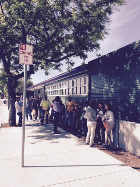 Parents waiting to pick up their children outside a Rocketship school in San Jose.