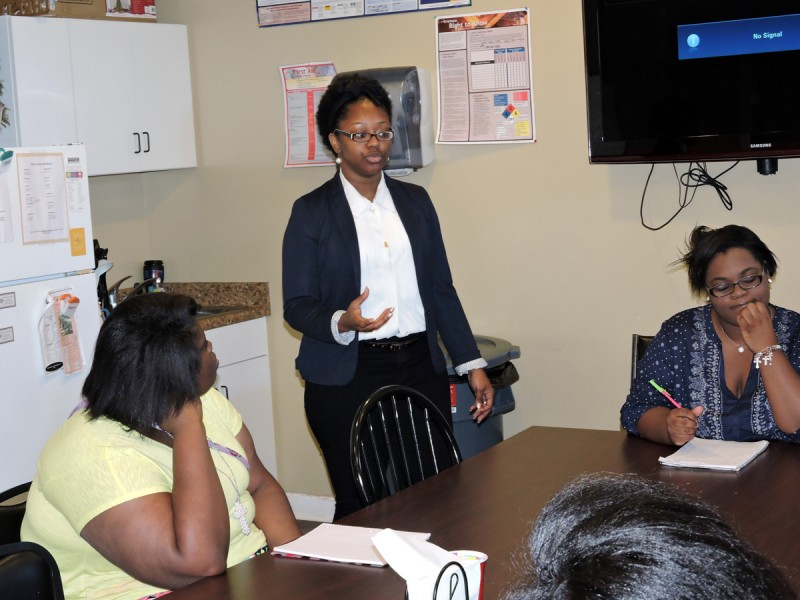 Marjada Tucker lectures teens in her summer program in Starkville inside a conference room at Baze Pharmacy.