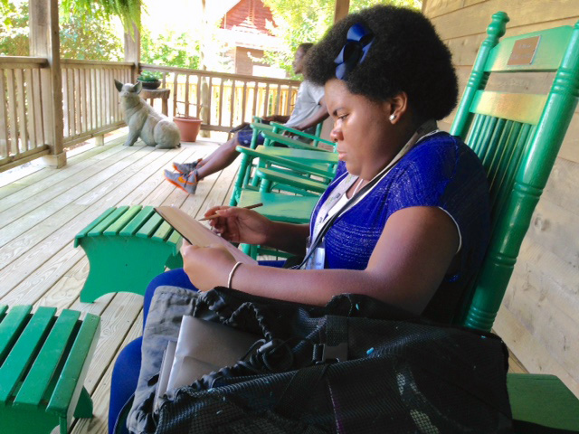 Slywenda Geeston jots notes after leaving a workshop during the second day of the Proctor Institute retreat.
