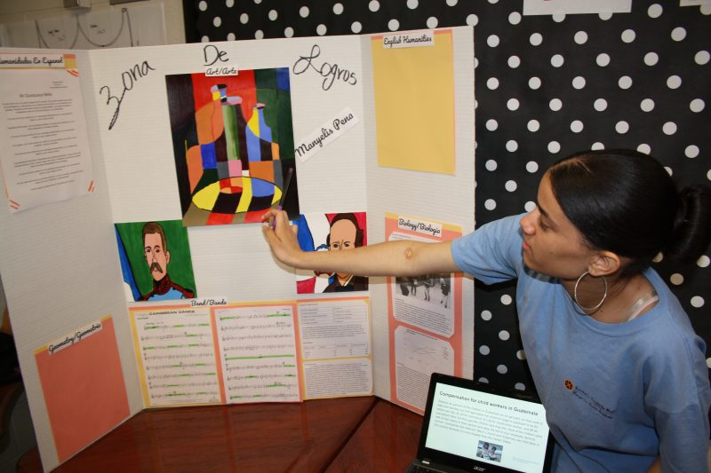 """Manyelis Peña presents during """"Zona de Logros,"""" or """"Achievement Zone,"""" an annual spring event at which Muñiz Academy students describe their best work from the year in Spanish and English."""