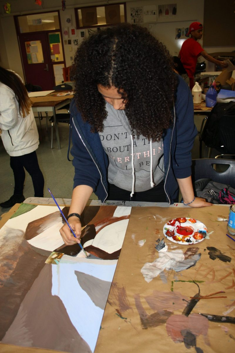 Carla Savinon, now a sophomore, works on a painting in her visual arts class last spring at Boston's Margarita Muñiz Academy, where arts are a core component of the curriculum.