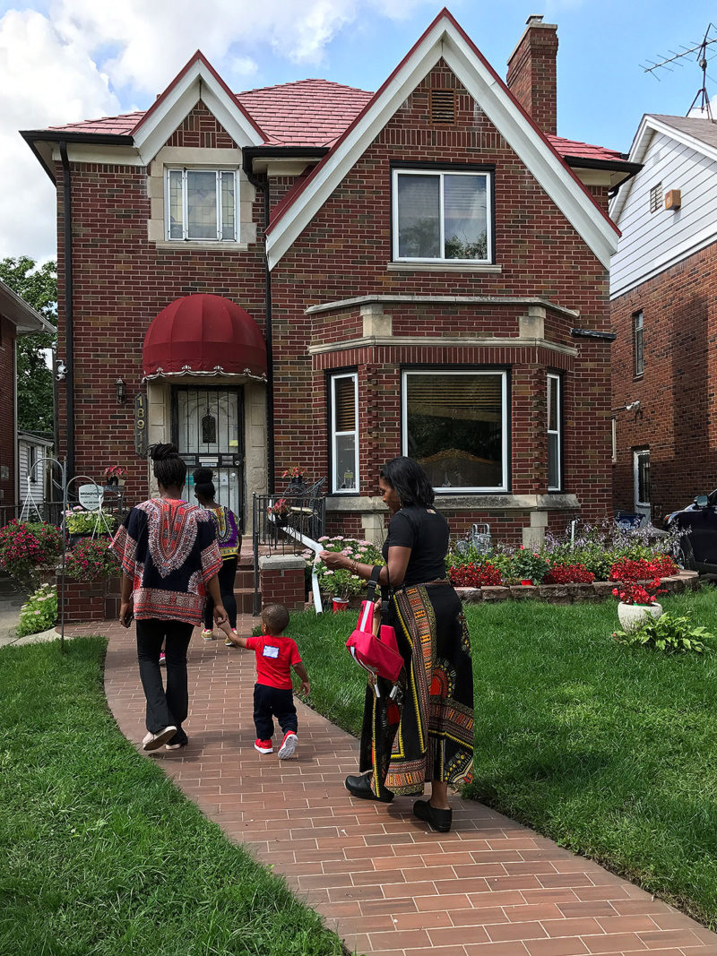 Lorna Parks, far right, returns home with her charges after their daily walk, part of the routine at Parks' home-based child care program.