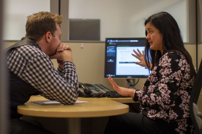 Client Paul Chirico of Los Angeles works with tax preparer Erika Arbulante to see how the Affordable Care Act, ACA, will impact his tax returns at H&R Block on January 8, 2015 in Los Angeles, California.
