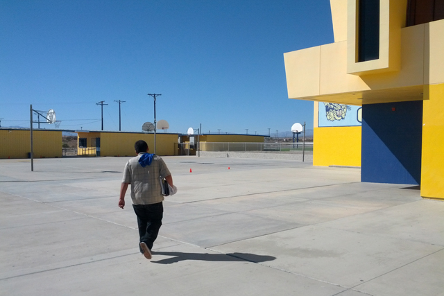 Students at West Shores High School walk through a courtyard between classes. The school, in Salton City, Calif., has a school bus with a Wi-Fi router to help keep students connected at home. (Credit: Nichole Dobo, The Hechinger Report)