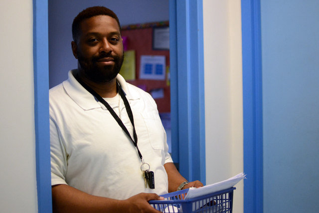 Sixth-grade teacher Tavares Bussey says even though the school day is shorter now, students are getting more out of the time they have. (Photo: Melissa Bailey)