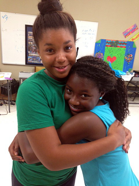 Sisters Kanita Perkins, 18, and Kaniya Perkins, 10, share a moment at the offices of the We2gether Creating Change program in Drew, Miss. (Photo: Nick Chiles)