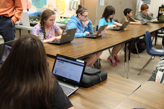 Students sit down to watch an online lesson on Roman life in Jennifer Harmsen's seventh-grade social studies classroom at Hillsborough Middle School in New Jersey. (Photo: Meghan E. Murphy)