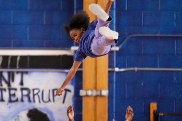 To land on her feet in cheerleading stunts, Nydresha must work hard while relying on her teammates. (Amanda Brown / NJ Spotlight)