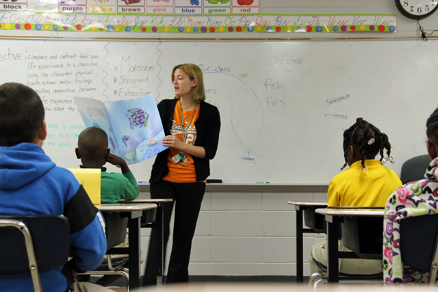 A summer school teacher in the Delta reads with her class. (Photo: Jackie Mader)