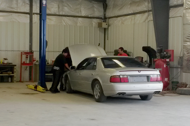 Students in Oglala Lakota's automotive program work on a car in the first week of classes. Administrators say there aren't enough jobs at area mechanics to go around after graduation. (Photo: Sarah Butrymowicz)