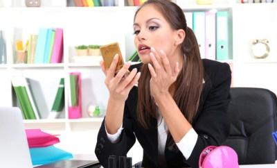 beauty travel tips woman applying makeup