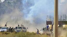 Smoke rises during clashes between irregular forces loyal to former army general Khalifa Haftar and Islamist militants in the eastern city of Benghazi