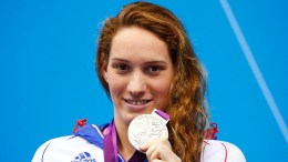 France's Camille Muffat poses with her silver medal for the women's 200m freestyle final with an Olympic record during the London 2012 Olympic Games at the Aquatics Centre