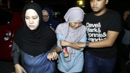 The mother of a missing Trigana Air plane crew member (C) cries as she walks out of Trigana Air main office, in Jakarta, Indonesia, 16 August 2015. Trigana Air Flight TGN267 from Jayapura to Oksibil, an ATR-42 turboprop aircraft, went missing over Papua with 54 on board, Indonesian authorities said on 16 August 2015. EPA/MAST IRHAM