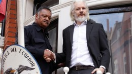A picture made available 22 August 2015 shows WikiLeaks founder Julian Assange (R) with US Reverend Jesse Jackson outside the Embassy of Ecuador in London, Britain. EPA, YUI MOK UK