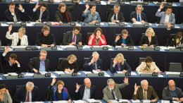 FILE PHOTO: Members of the European Parliament vote on the far-reaching abolition of roaming charges in the European Parliament in Strasbourg, France. EPA, PATRICK SEEGER