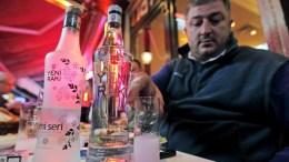 A file photo showing a man in a restaurant in Istanbul, Turkey, drinking a glass of the Turkish national drink Raki,. EPA/TOLGA BOZOGLU