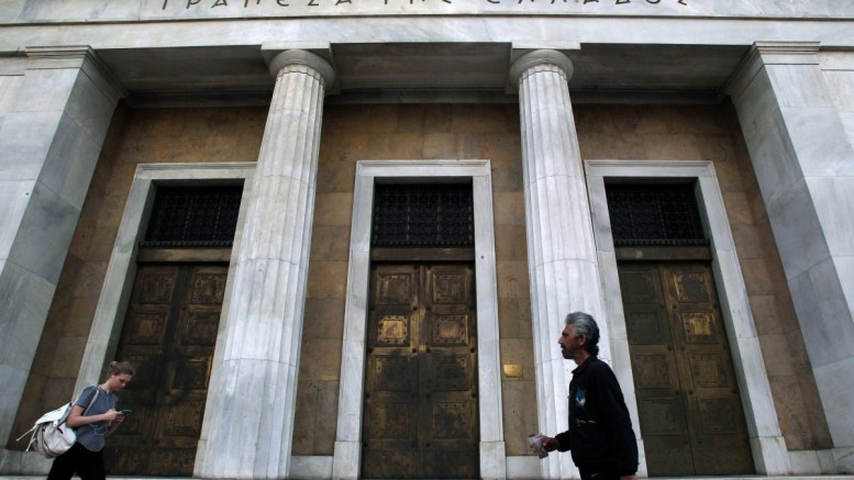 File Photo:  People pass by the Bank of Greece headquarters in Athens, Greece. EPA, SIMELA PANTZARTZI