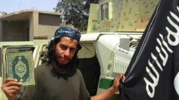 A framegrab made from an undated video released by the jihadist group calling itself Islamic State (IS) allegedly showing Abdelhamid Abaaoud posing with a Koran and the ISIS flag. EPA IS USING AN IMAGE FROM AN ALTERNATIVE SOURCE AND CANNOT PROVIDE CONFIRMATION OF CONTENT, AUTHENTICITY, PLACE, DATE AND SOURCE. HANDOUT EDITORIAL USE ONLY/NO SALES