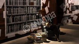 A man reads a book displayed at the 'BookCrossing Zone' at the exhibition 'Das bewegte Buch' (lit. the moved book) at the Literaturmuseum in Marbach am Neckar, Germany, EPA, WOLFRAM KASTL