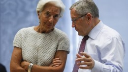 International Monetary Fund managing director Christine Lagarde (L)  with Managing Director of ESM, Klaus Regling. EPA, OLIVIER HOSLET