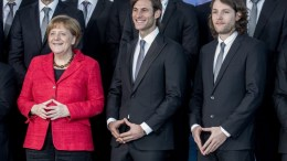 German Chancellor Angela Merkel (L) poses together with the players of the German National Handball team in Berlin, Germany, 09 March 2016. Uwe Gensheimer (C) and Johannes Sellin (R) are forming the 'Merkel diamond' with their hands. Merkel received the team after their victory at the European Championship 2016 in Poland in the chancellery. EPA, MICHAEL KAPPELER
