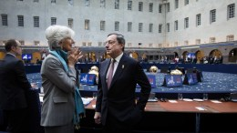 File Photo: International Monetary Fund (IMF) Managing Director Christine Lagarde (C) and Mario Draghi, President of the European Central Bank (ECB) talk during a meeting of the Eurozone Finance Ministers at the Scheepvaartmuseum in Amsterdam, The Netherlands. EPA, BART MAAT
