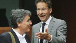 Greek Finance Minister Eucleidis Tsakalotos (L) is welcomed by the President of Eurogroup, Dutch Finance Jeroen Dijsselbloem (R), prior to the start of an Eurogroup Finance ministers meeting in Brussels, Belgium. EPA, OLIVIER HOSLET