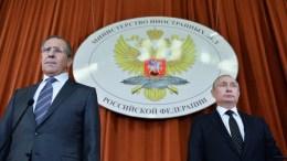 Russian President Vladimir Putin (R) and Russian Foreign Minister Sergei Lavrov. EPA, ALEXEI DRUZHININ, SPUTNIK, KREMLIN POOL MANDATORY CREDIT