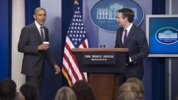 FILE PHOTO: US President Barack Obama, with White House spokesman Josh Earnest (R). EPA, SHAWN THEW