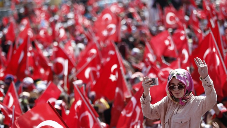 FILE PHOTO: People wave Turkish flags during a rally to protest at the failed coup attempt of 15th July 2016. EPA/SEDAT SUNA