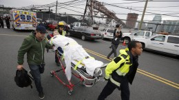 FILE PHOTO. A person is taken on a stretcher after a train accident. EPA, GARY HERSHORN