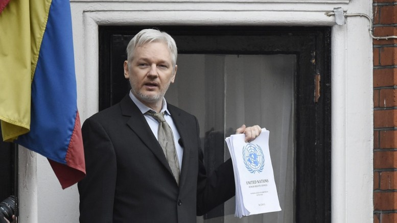 A file picture shows Julian Assange speaking to the media from a balcony of the Ecuadorian Embassy in London. EPA/FACUNDO ARRIZABALAGA
