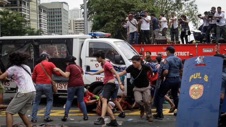 A police mobile runs over protesters during a protest in front of the US Embassy in Manila, Philippines, 19 October 2016. Hundreds of protesters including Indigenous People, students and militant groups stormed toward the US Embassy to protest against the presence of US military troops and to support Philippine President Rodrigo Duterte's independent foreign policy pronouncements. The protest ended violently as the protesters clashed with the police during the dispersal. Initial reports said at least five protesters and around thirty police officers were hurt. EPA/MARK R. CRISTINO